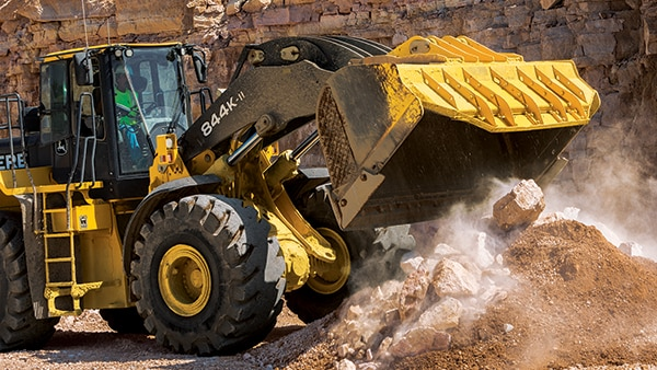 An 844K-II Wheel Loader unloads rock and soil at the jobsite