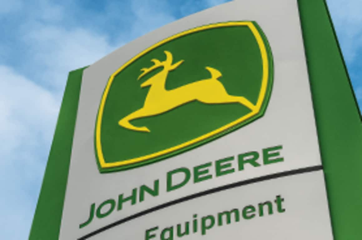 A John Deere dealership sign as seen from below