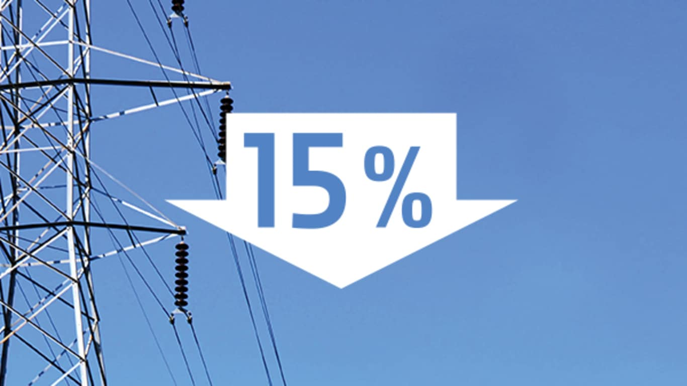 Image of a power line tower with blue sky in the background and a white down arrow with 15% inside in the foreground