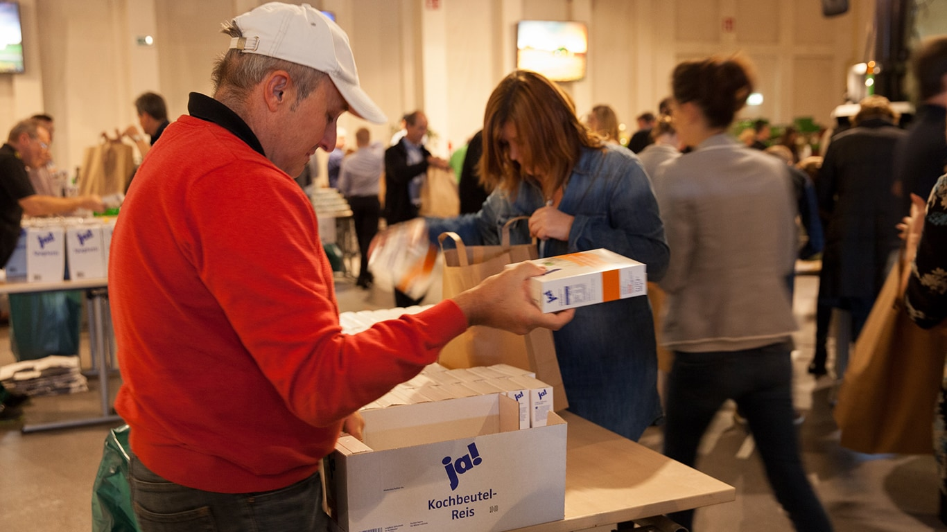 Employees in Germany fill bags with food for a local food bank