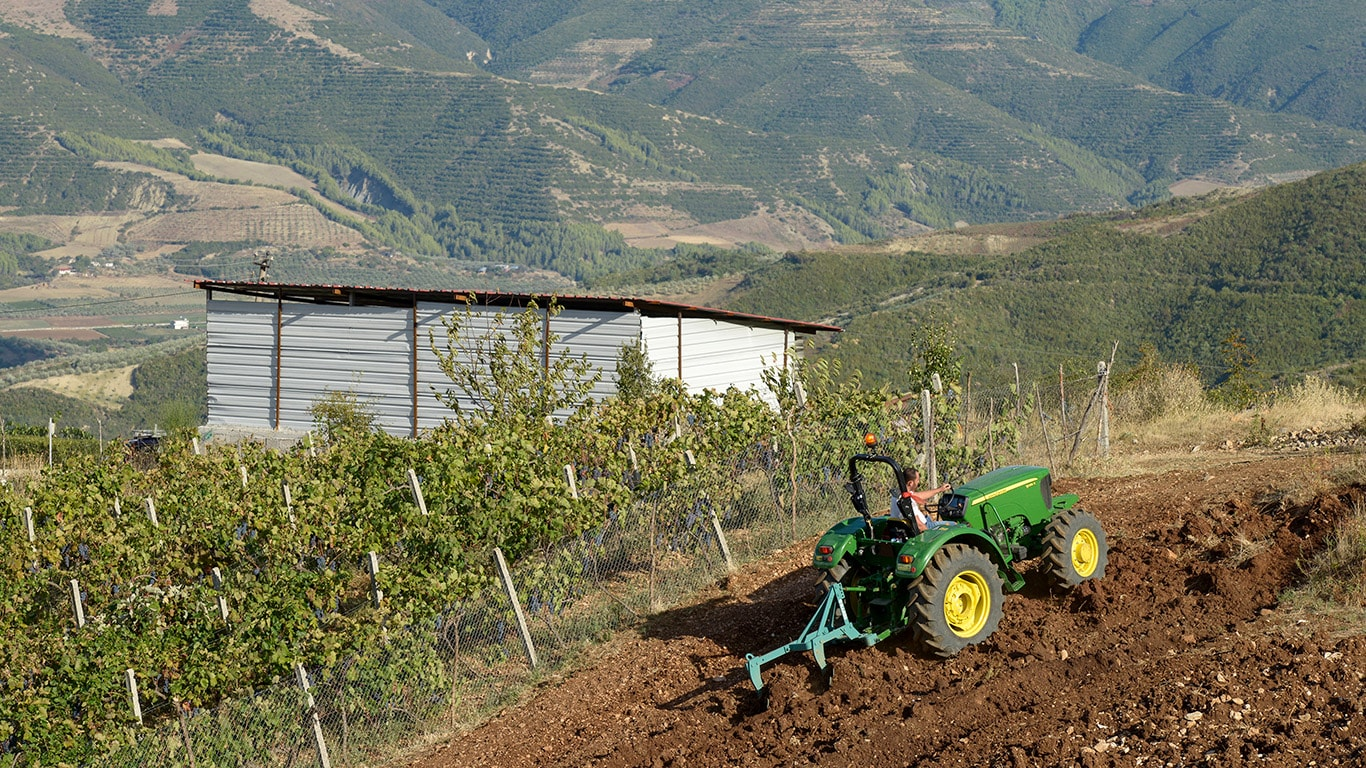 Cultivating the soil on slopes poses additional challenges for the driver and his machine.