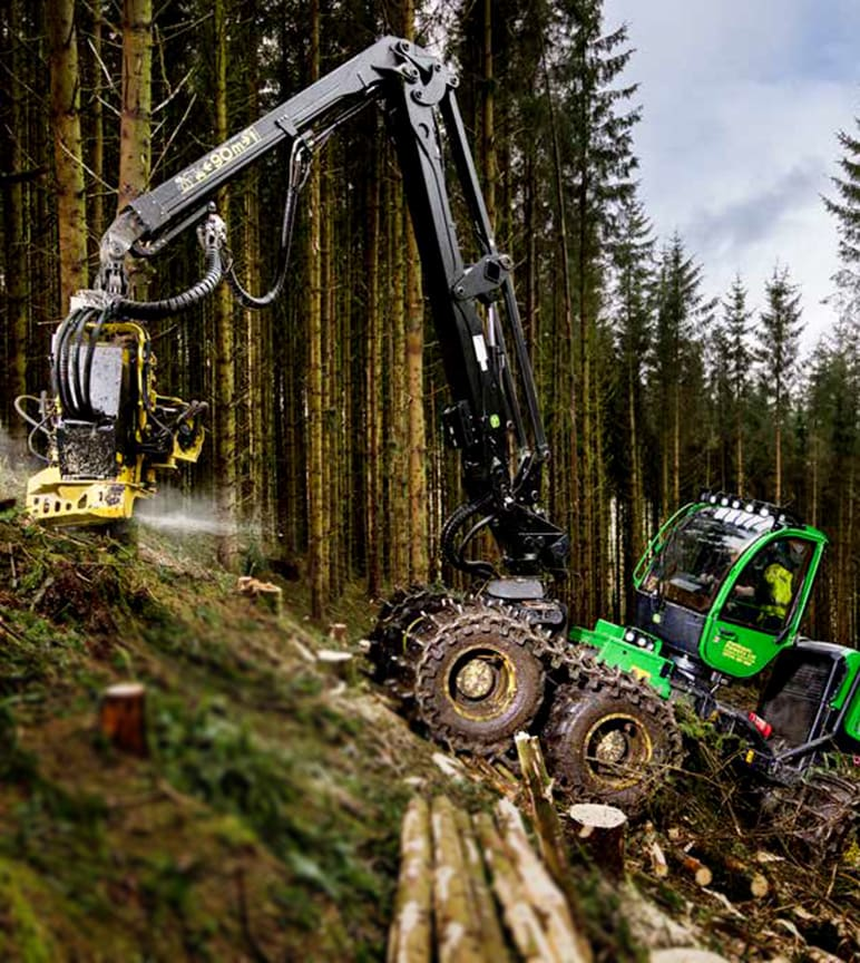 John Deere forest machine working on a slope