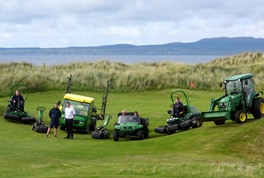 Machrie Golf Links course manager Dean Muir with Nairn Brown Ltd sales manager Andy Gillies (standing left & right), with the greenkeeping staff and a selection of their new John Deere machines.