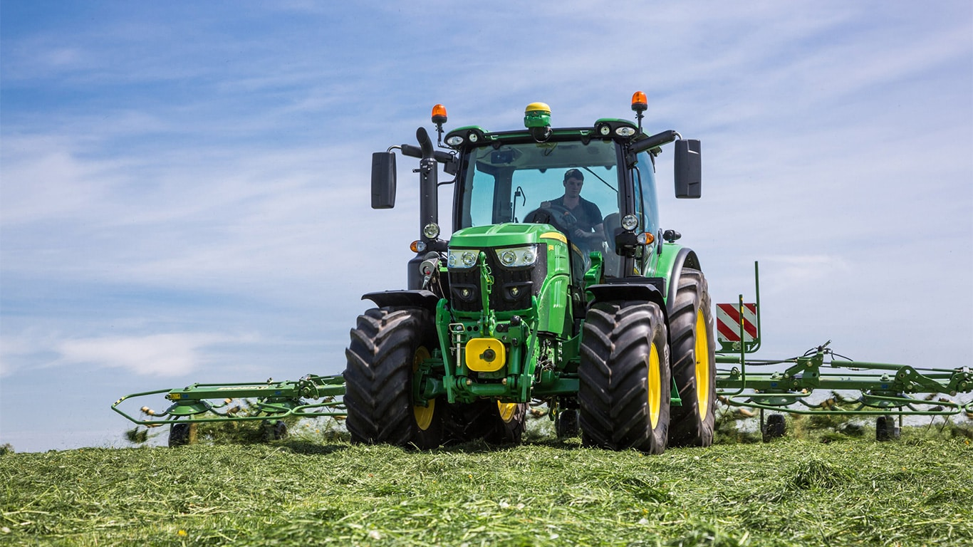 The mid-size 6130R tractor features John Deere's new Stage IV engine.