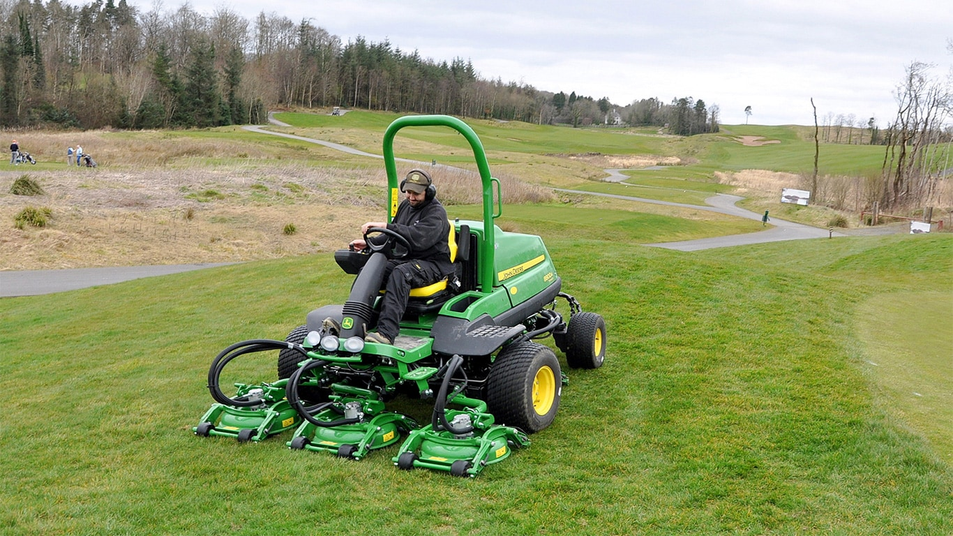 One of the two new John Deere 8800A TerrainCut rough mowers at work.