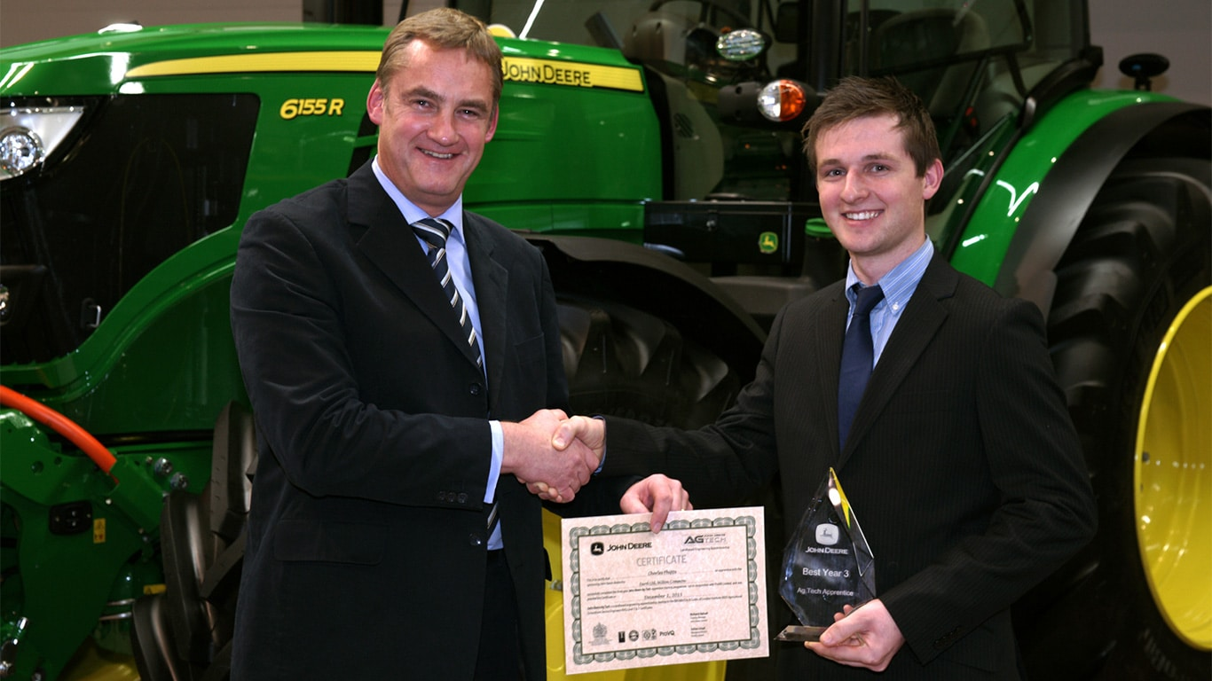 John Deere ag & turf apprentice of the year 2015 Charlie Phipps with training centre manager Richard Halsall.