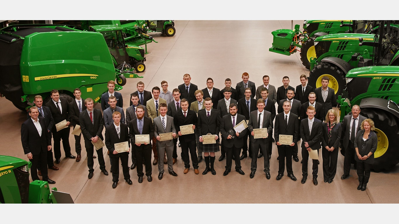 John Deere's 2015 Ag Tech, Parts Tech and Turf Tech third year graduates at the John Deere Forum in Mannheim, Germany.
