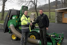 Frank Sutton's turf equipment manager Gareth Beck (right) hands over the new John Deere 1580 front rotary mower to RWAS estate manager Andrew Crockett.