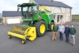 John Deere dealer Johnston Gilpin's sales director Robbie Hewitt, Garth Cairns and Tim Black of Garth Cairns Contracting, and the dealership's managing director Randal McConnell with the newly delivered 8800i self-propelled forage harvester.