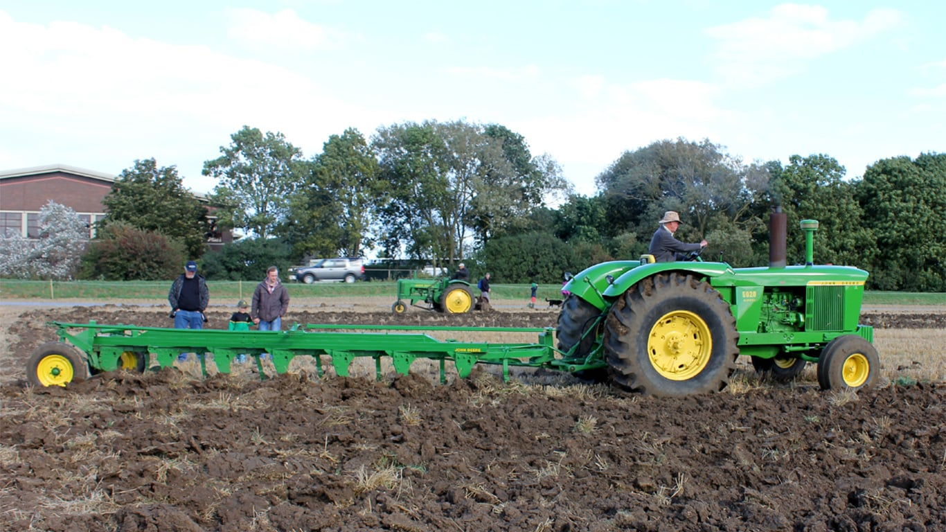 David Leech and his pioneering 1965 5020 tractor & F135H seven-furrow plough – these and the 530 combine were in John Deere Ltd's initial product range in 1966.