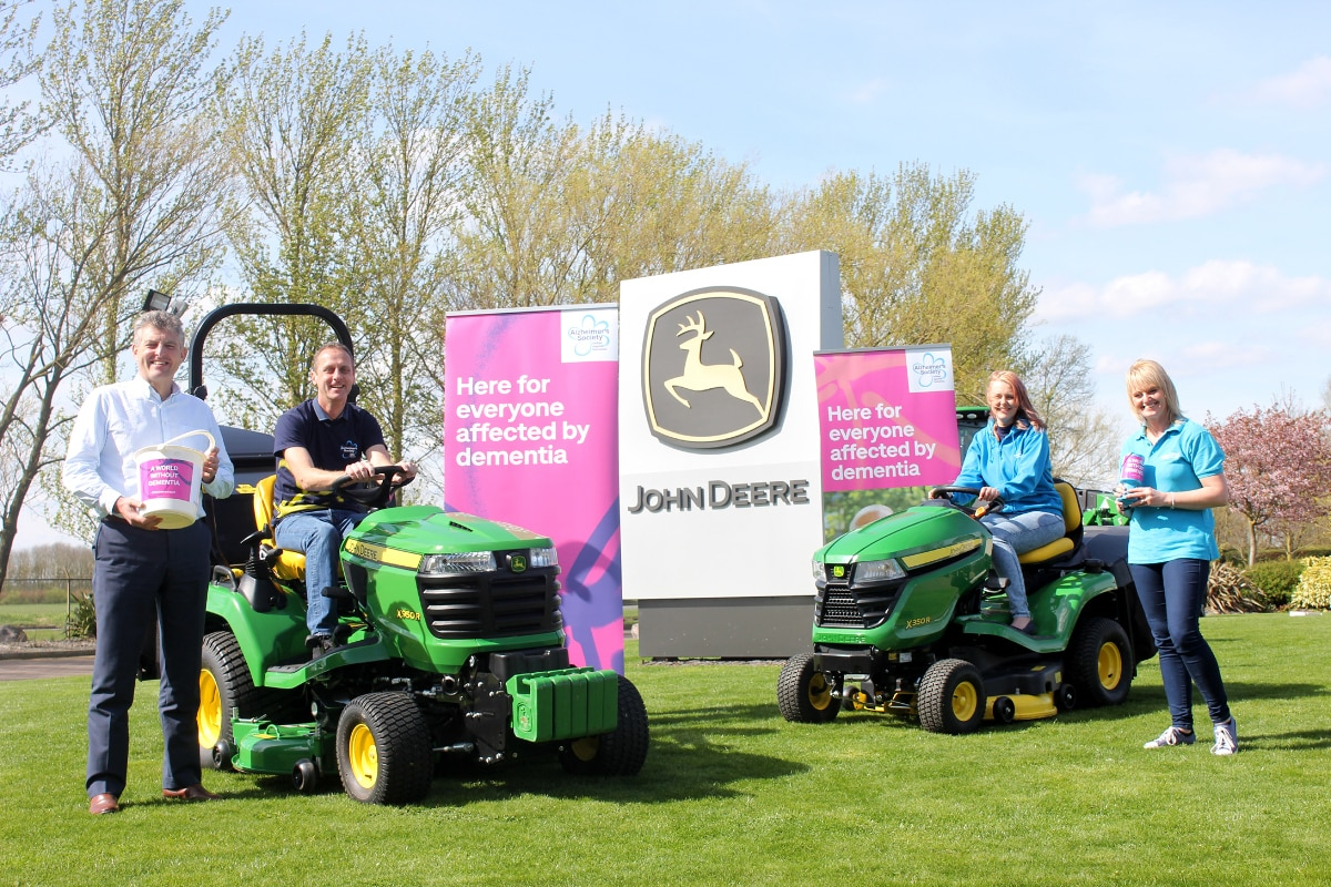 (Left to right): John Deere turf division manager Chris Meacock, Andy and Kathryn Maxfield, and Sue Swire of Alzheimer's Society.