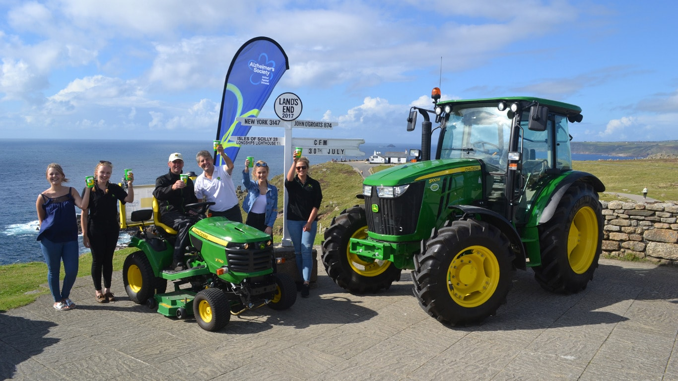 We made it! (Left to right) Kathryn, Joanne, Andy, Chris, Kaitlyn & Becca at Land's End with the X750 and a 5100M from local dealer Cornwall Farm Machinery.