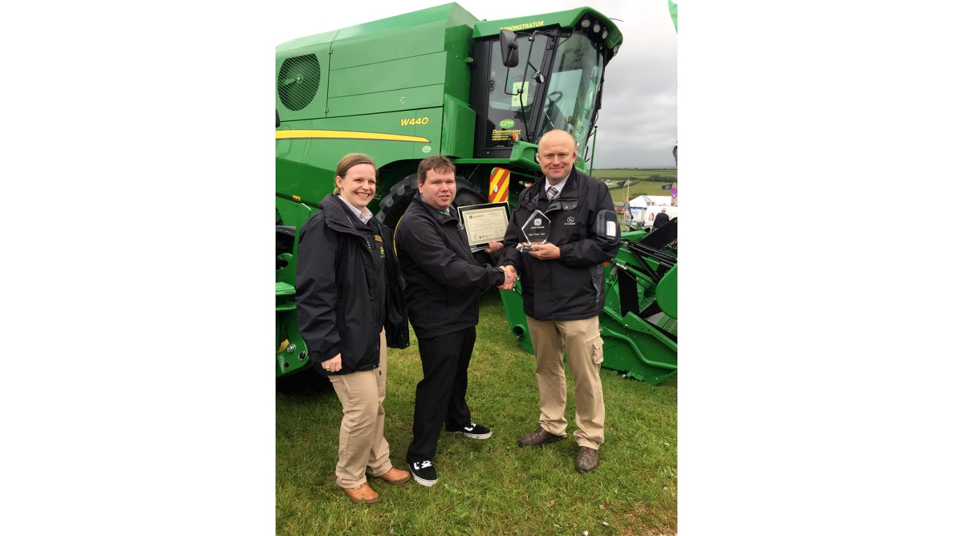 John Deere Parts Tech Apprentice of the Year Grant Roberts of Cornwall Farm Machinery (centre) was presented with his award at the Royal Cornwall Show.