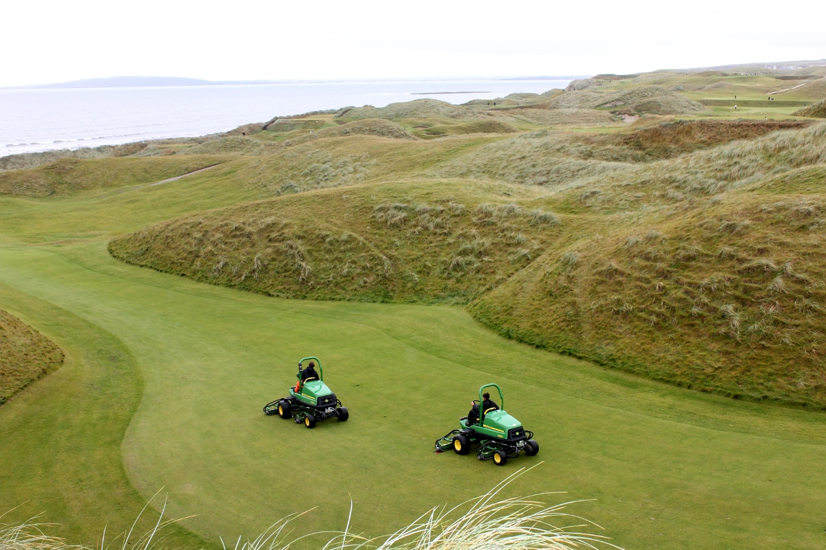 Two of Ballybunion's new John Deere fairway mowers at work.