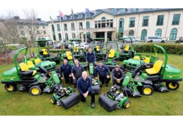 The Vale Resort's greenkeeping, sports and estates administrator Kim Chilton (front), with some of the greenkeeping staff and their new John Deere machines.