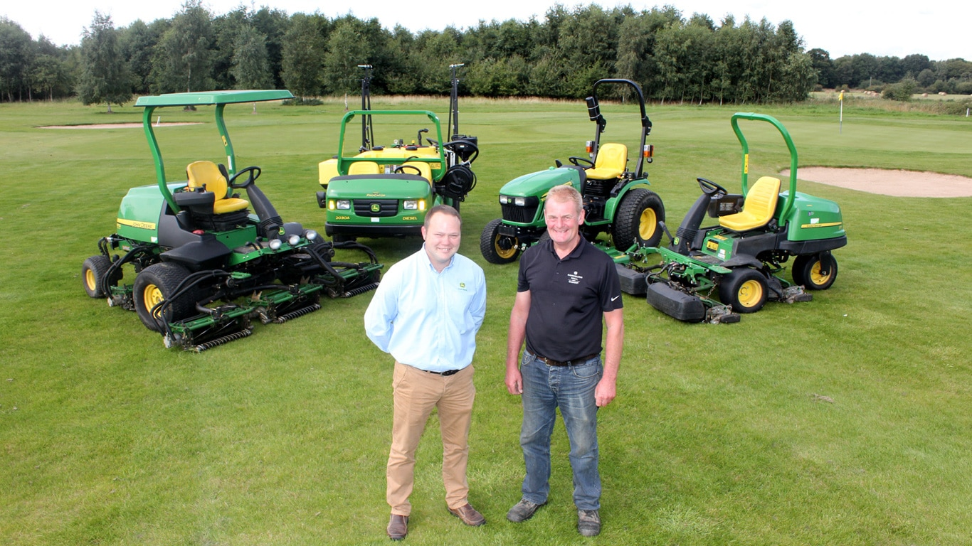 Dealer Andy O'Neill of F G Adamson & Son (left) with Sandburn Hall's golf course manager Brian Hall and some of the club's latest John Deere machines.