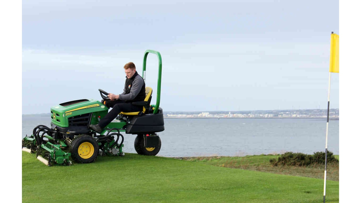 Deputy course superintendent Gary Byrne driving a John Deere 2653B tees & surrounds mower at Galway Bay Golf Resort.