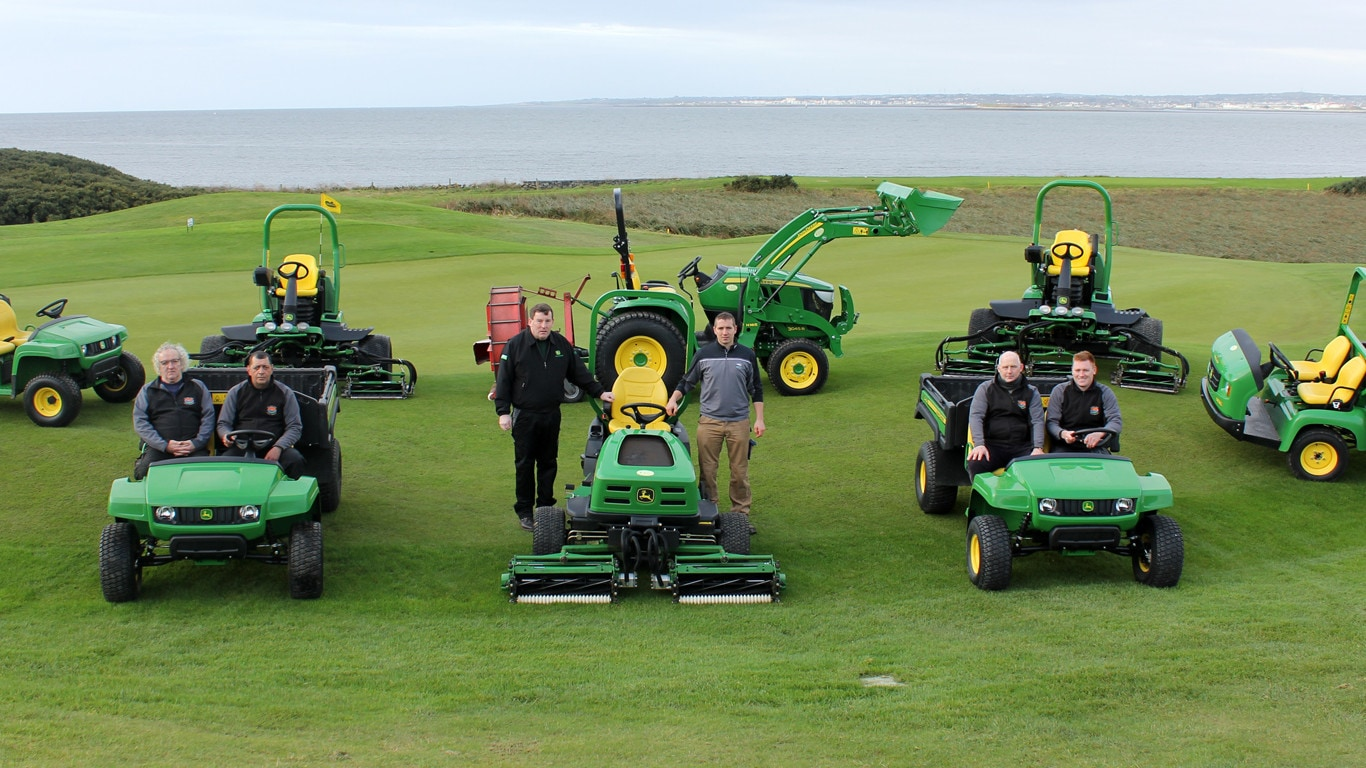 Ger Conway of Mid West Mowers and Galway Bay Golf Resort course superintendent Damien Coleman (standing left & right), with the greenkeeping team and new fleet.