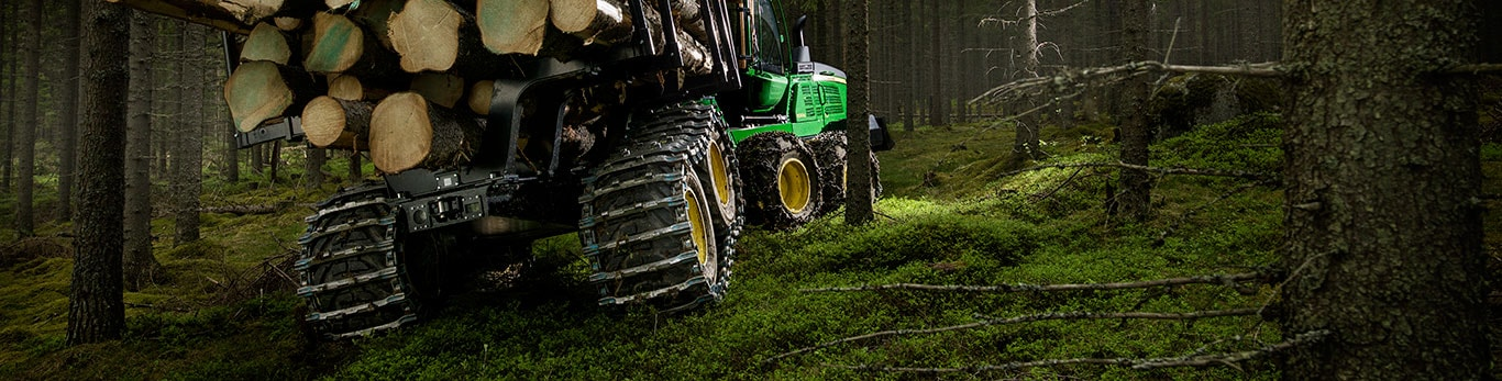 John Deere 1510G is forwarding wood in the forest