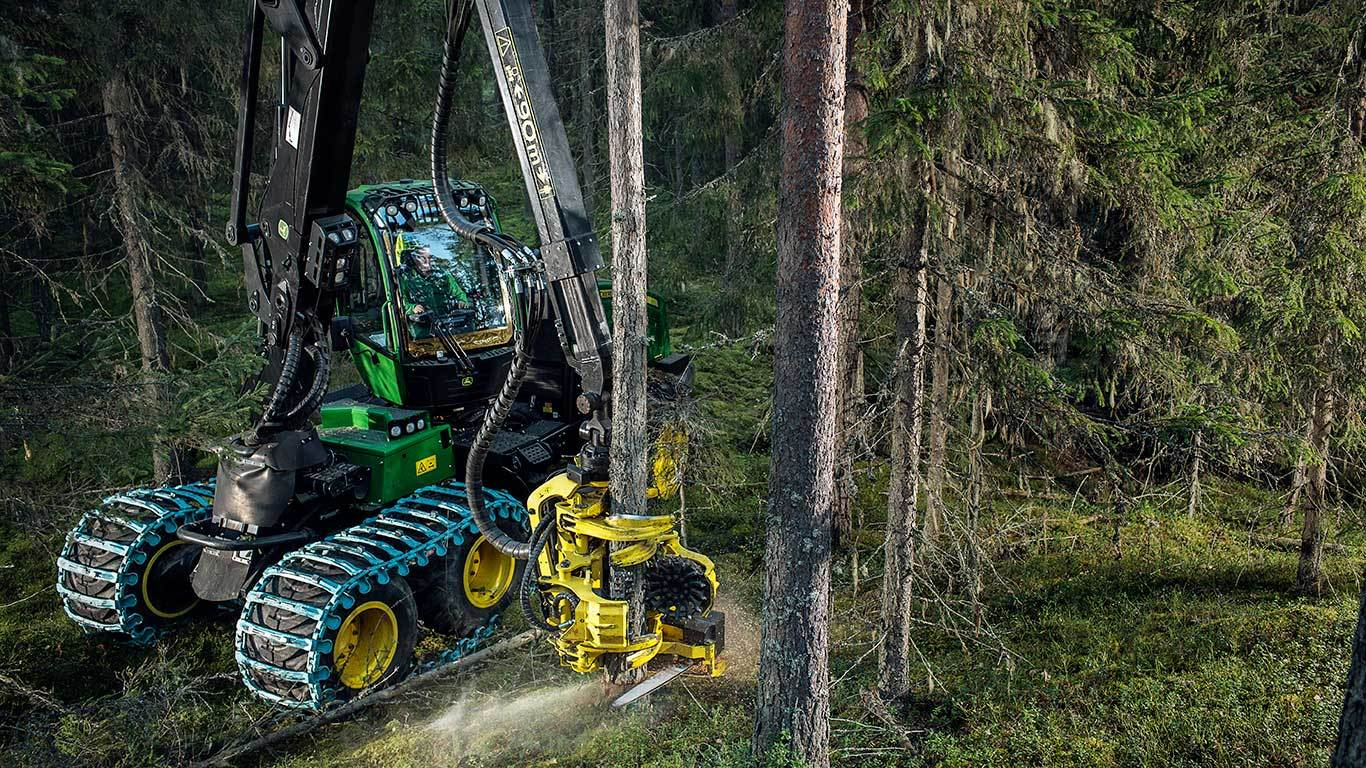 John Deere 1170E harvester felling a tree