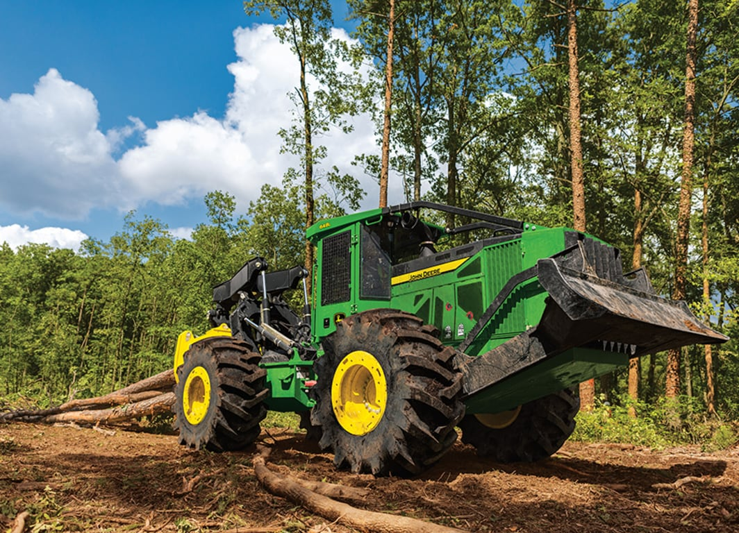 John Deere 648L skidder working in the forest
