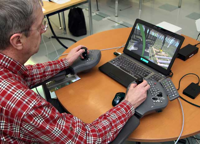 Laptop simulator installed in a work station