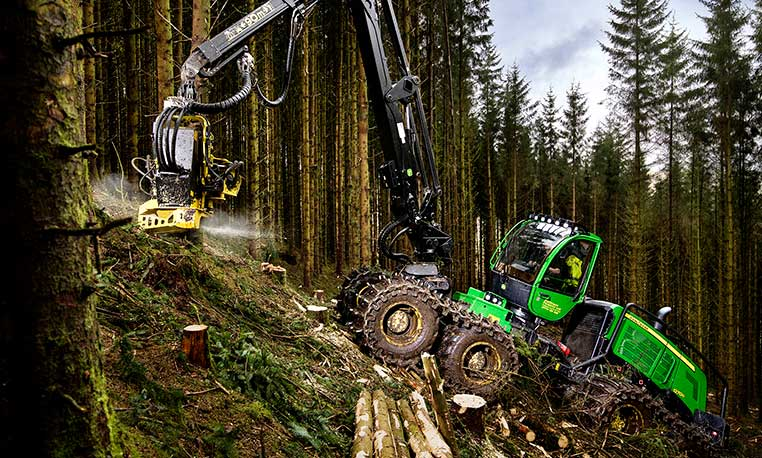 John Deere 1270G 8-wheeled harvester working on a steep slope in UK